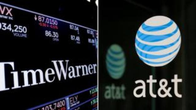 combination photo shows the Time Warner shares price at the New York Stock Exchange and AT&T logo in New York, NY, U.S., on November 15, 2017 and on October 23, 2016 respectively.