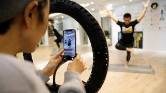 A Beijing exercise class is live-streamed