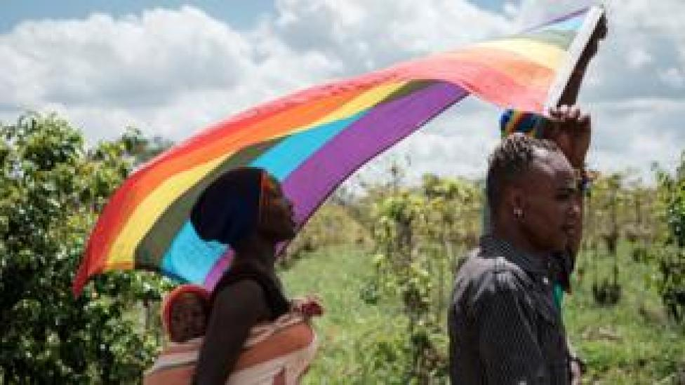 LGBT refugees from South Sudan, Uganda and DR Congo walk on the way to their protest to demand their protection at the office of the United Nations High Commissioner for Refugees (UNHCR) in Nairobi, Kenya, on May 17, 2019. - According to them, they have fled from Kakuma and Dadaab refugee camps in northern Kenya to avoid life threatened incidents and stayed in front of UNHCR office building in Nairobi since January.