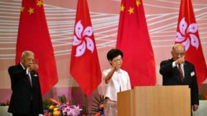 Carrie Lam at a flag-raising ceremony in Hong Kong on Wednesday