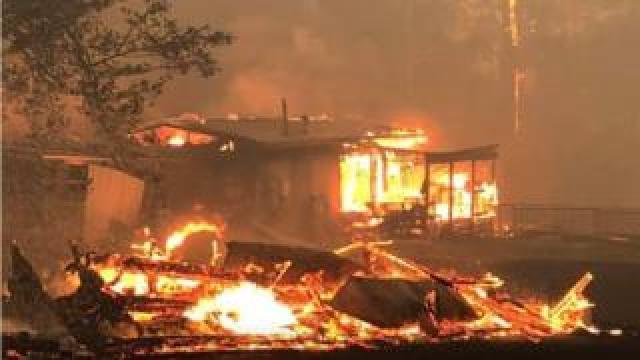 The couple's house burning