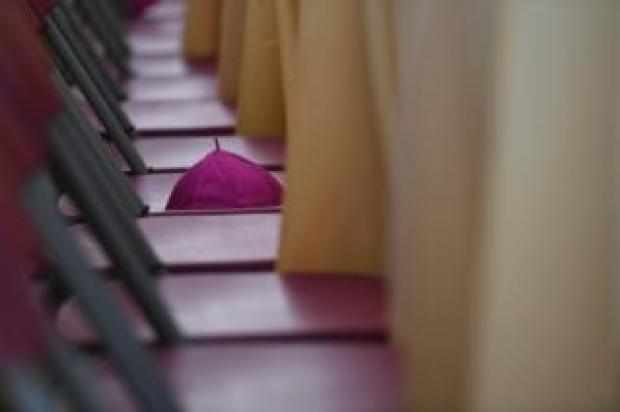 """An Archbishop""""s hat is seen on a chair during Mass at the Pastoral Congress at the World Meeting of Families in Dublin, Ireland"""
