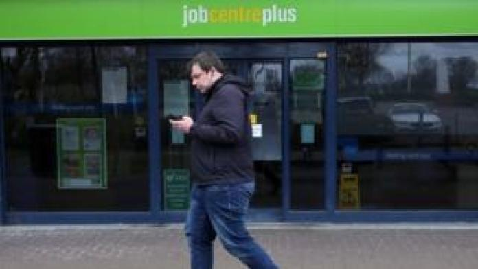 Man walks past job center