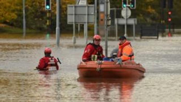 Rescuers using a boat to travel in Rotherham