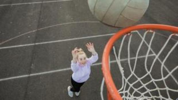 Girl scores netball goal