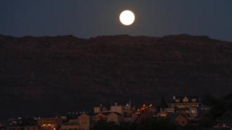 A supermoon rises over Table Mountain in Cape Town, South Africa - Sunday 3 December 2017
