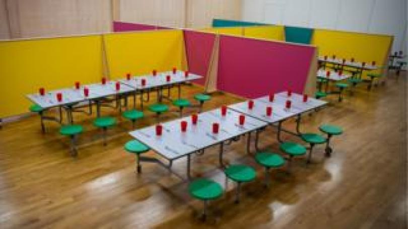 Lunch spaces for different classes separated and spaced as The Charles Dickens Primary School