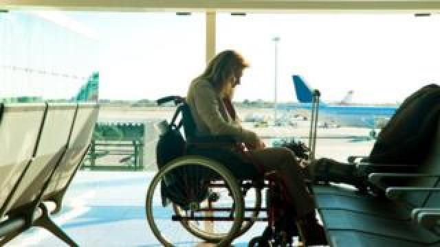 wheelchair user in departure lounge
