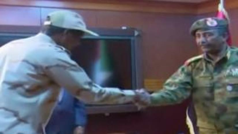 Hemeti in military clothes being sworn in as deputy of Sudan's transitional military council in Khartoum
