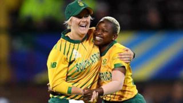 Nonkululeko Mlaba of South Africa (R) celebrates with Dane Van Niekerk (L) after taking a wicket in Sydney, Australia - Thursday 5 March 2020