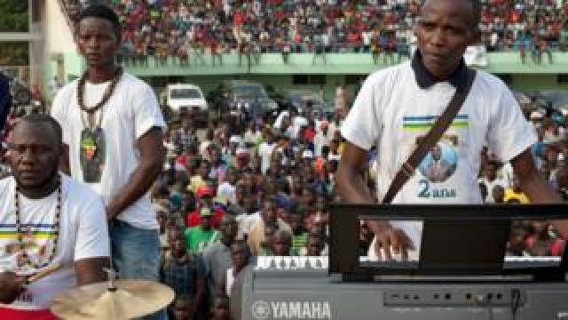 The band Nouvelles Écritures (Emmanuel Ngallos on keyboards) performing at a stadium in Bangui, CAR in March 2018