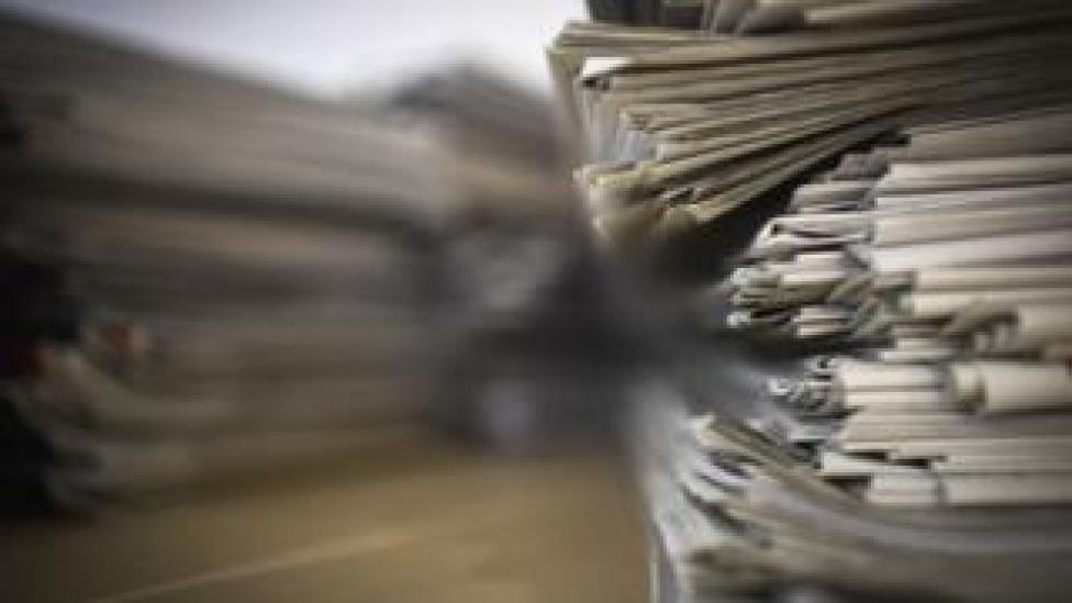 NEWS A stack of newspapers