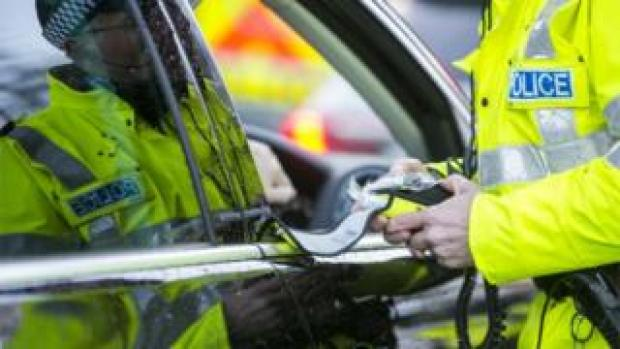 Police officer with breath test