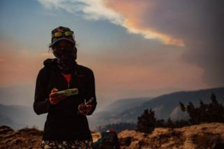 Hiker in Sierra National forest amid a wildfire