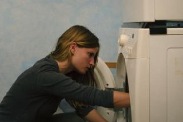 Maddie does the laundry