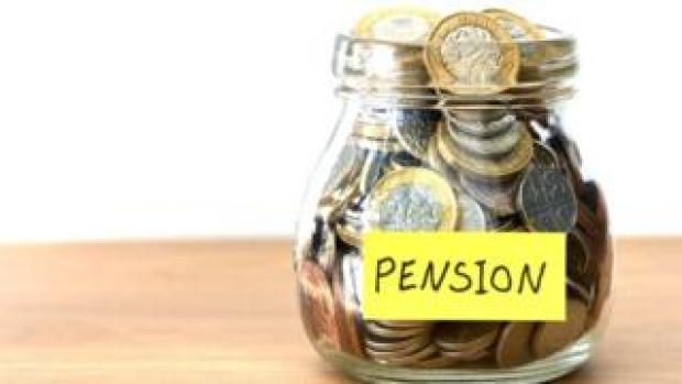 "Money in a jar marked ""pension"""