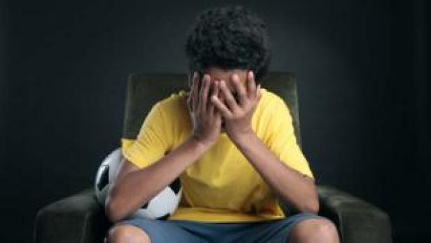 A young upset footballer