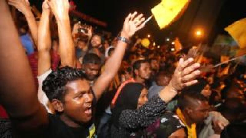 Supporters of Maldivian joint-opposition presidential candidate Ibrahim Mohamed Solih celebrate on the street