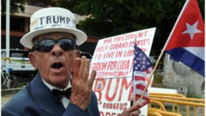 A pro-Trump supporter in 2017 with a sign supporting the president's action on Cuba