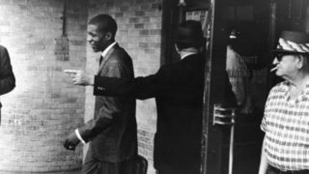 """A young Black """"Freedom Rider"""" is told to leave a segregated """"white"""" waiting room at a bus depot in Jackson, Mississippi, May 26, 1961"""