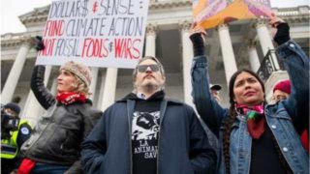 Tara Houska (right) protesting in Washington DC alongside actor Joaquin Phoenix