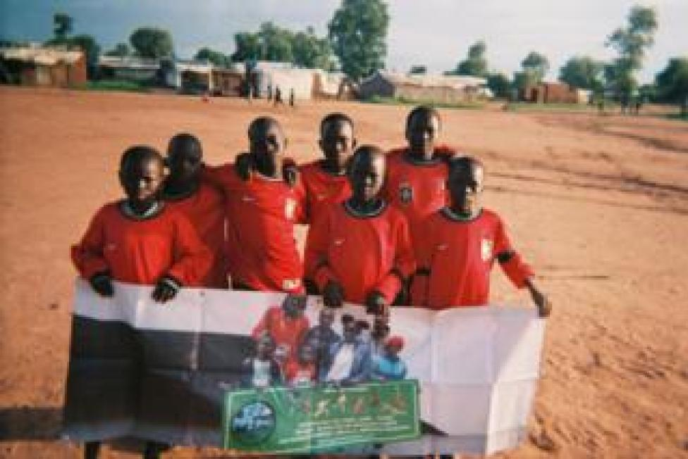 sport A group of children hold a placard