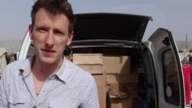 File photo: Peter Kassig in front of a truck somewhere along the Syrian border between late 2012 and autumn 2013