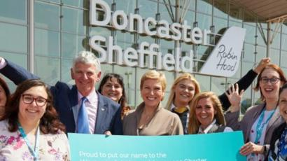 Robert Hough of Doncaster Sheffield Airport with Aviation Minister Baroness Charlotte Vere, and DSA's female employees