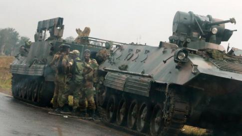 Soldiers stand beside military vehicles just outside Harare, Zimbabwe, 14 November 2017