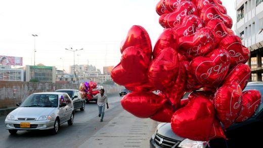 File photo: Heart shaped balloons on a street in Karachi, 14 February 2011