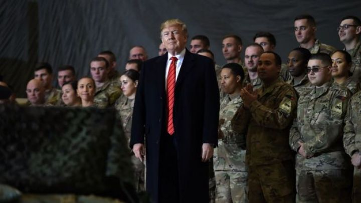 Donald Trump with army personnel standing behind him in Afghanistan