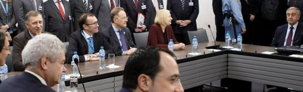 Greek Cypriot President Nicos Anastasiades, Special Adviser to the United Nations Secretary-General on Cyprus Espen Barth Eide and Turkish Cypriot leader Mustafa Akinci attend a new round of Cyprus Peace Talks, at the European headquarters of the United Nations in Geneva on Monday, 9 January