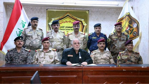 Iraqi Prime Minister Haider al-Abadi, center, surrounded by top military and police officers as he announces the start of the operation to liberate the northern city of Mosul from Islamic State militants