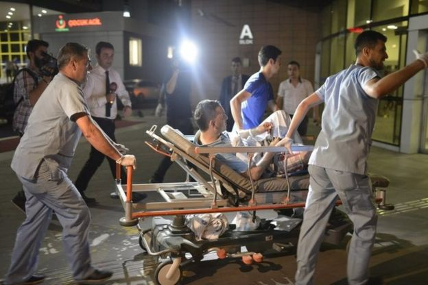 Medics take an injured man to hospital in Istanbul