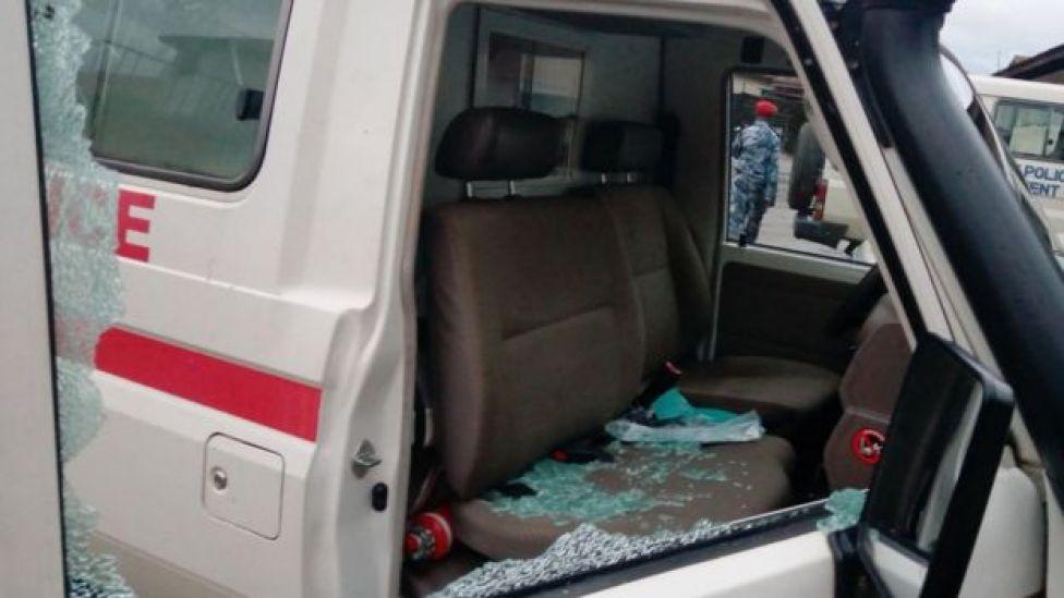 Image shows a damaged Red Cross ambulance