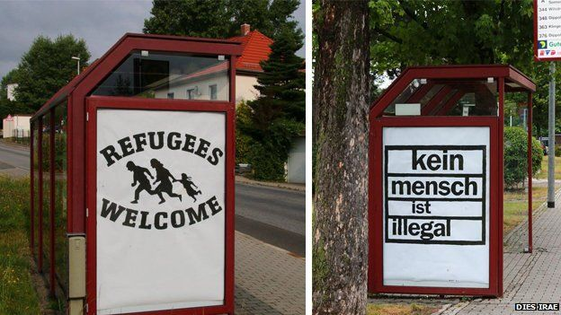 Two posters, one reading 'refugees welcome' and another reading 'Nobody is illegal'