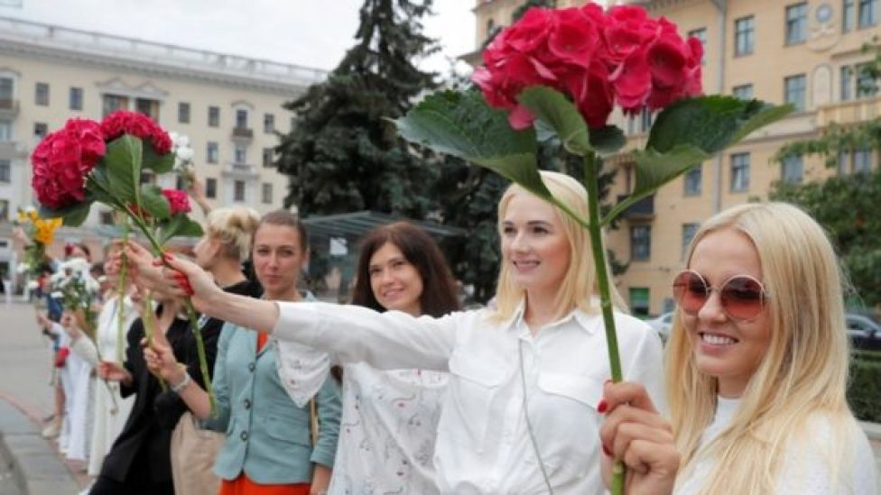 Women hold flowers during a demonstration against violence following recent protests to reject the presidential election results in Minsk, Belarus August 20, 2020