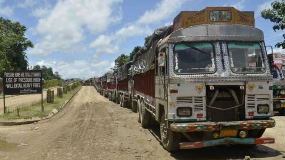 Indian vehicles stranded by bad weather wait at the side of the National Highway 44 at Churaibari some 80 kms north of Karimganj on the border of the north-eastern states of Assam and Tripura on July 11, 2016.