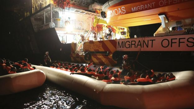 Migrants on dinghy boats are being rescued by the vessel Responder, run by the Malta-based NGO Migrant Offshore Aid Station (MOAS) and the Italian Red Cross, in the Mediterranean sea, early Saturday, Nov. 5, 2016.