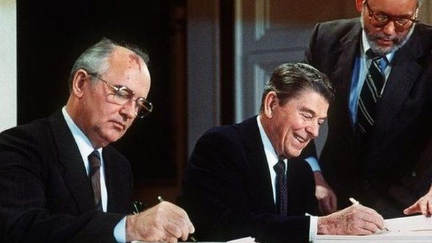 Mikhail Gorbachev and Ronald Reagan signing the INF Treaty in 1987