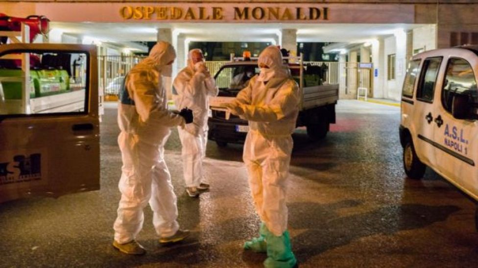 Doctors wear protective clothes against coronavirus in Naples