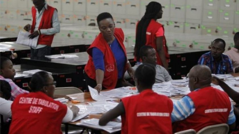 Electoral workers count ballots at a tabulation center in Port-au-Prince, Haiti, Monday, Nov. 21, 2016