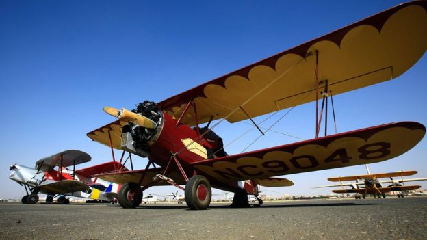 Travel Air 2000 biplane sits on runway on November 20, 2016 in Khartoum airport during the Vintage Air Rally