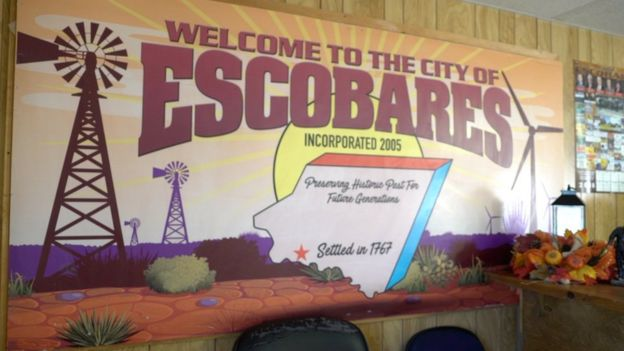 "Cartel ""Welcome to the city of Escobares"""