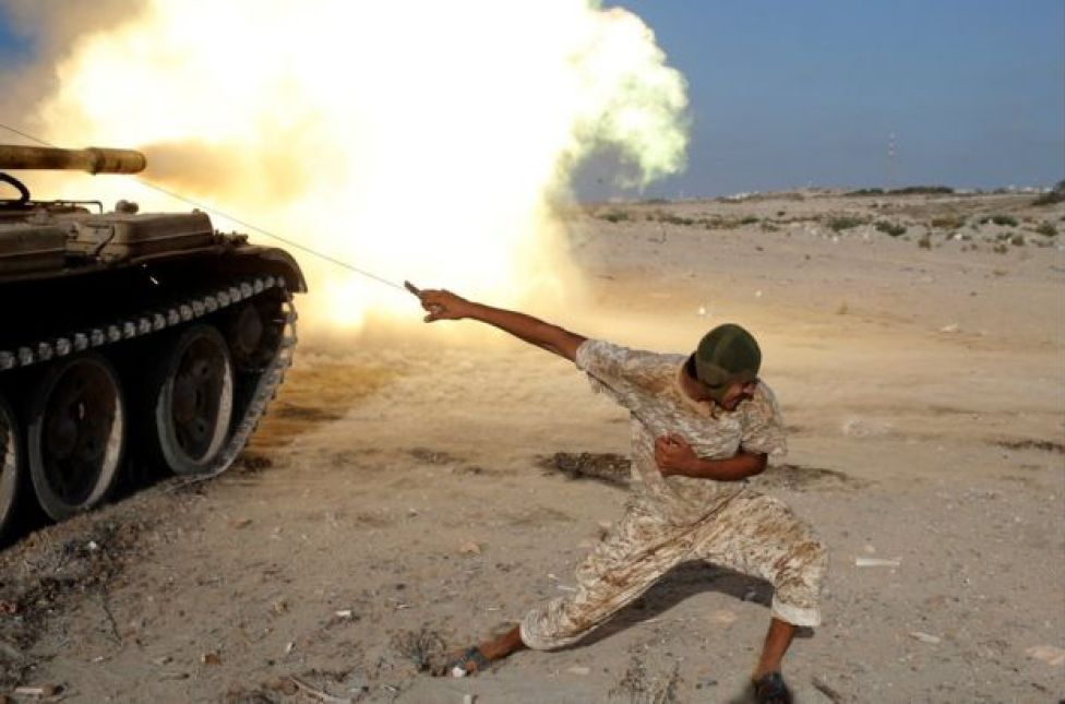 A fighter of Libyan forces allied with the U.N.-backed government fires a shell with Soviet made T-55 tank at Islamic State fighters in Sirte, Libya, August 2, 2016