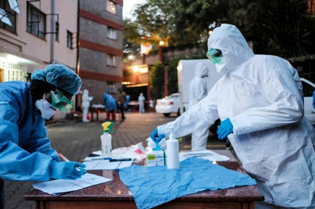 Doctors prepare to administer the mandatory COVID-19 coronavirus test for detainees of a Government designated quarantine facility in Nairobi on March 29, 2020