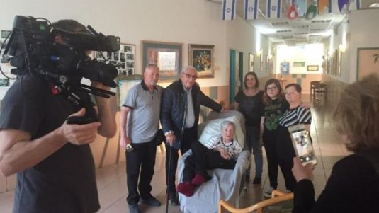 Maxwell Smart (second left) meets Tova (centre) surrounded by her family and documentary crew