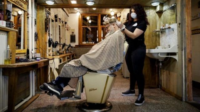Hairdresser Robert Verhulst and his staff prepare and practice for a possible reopening of his business in Gouda