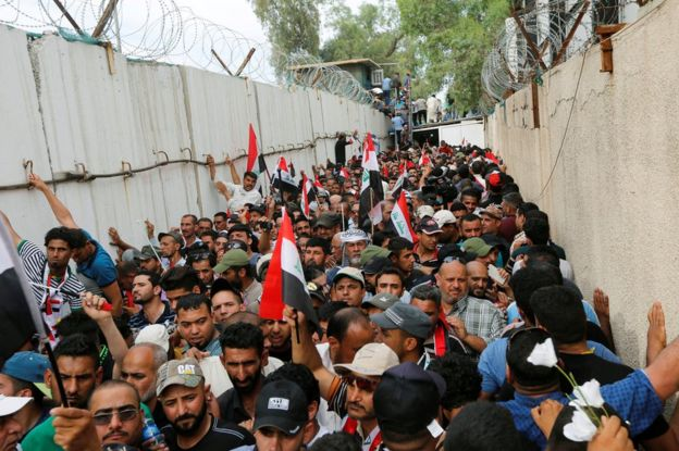 Protesters slip through blast walls near parliament in Baghdad, 30 April
