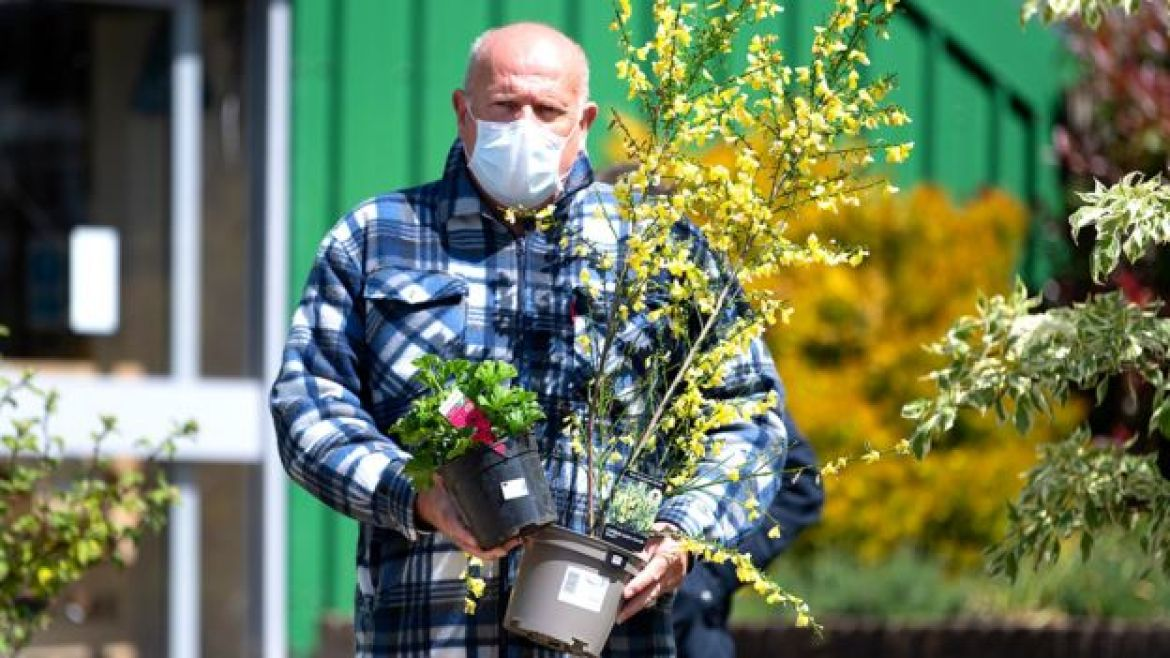 Man wearing a face mask leaving a garden centre in Wales